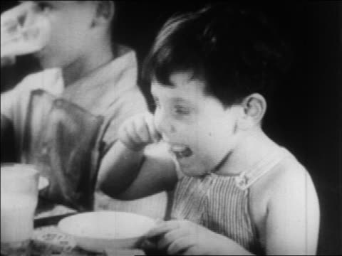 close up little boy eating in nursery school / wpa project / newsreel - 1934 stock videos & royalty-free footage