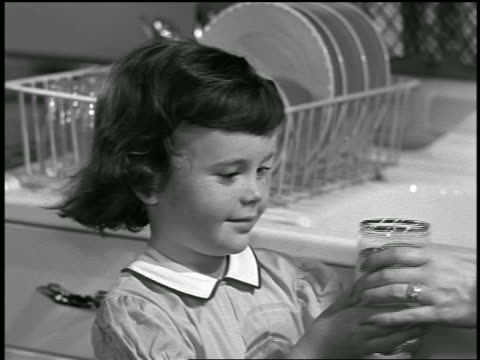 b/w 1952 close up little girl drinking glass of water / industrial - drinking glass stock videos & royalty-free footage