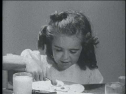 b/w 1949 close up little girl eating cereal at breakfast table - 1949 stock videos & royalty-free footage