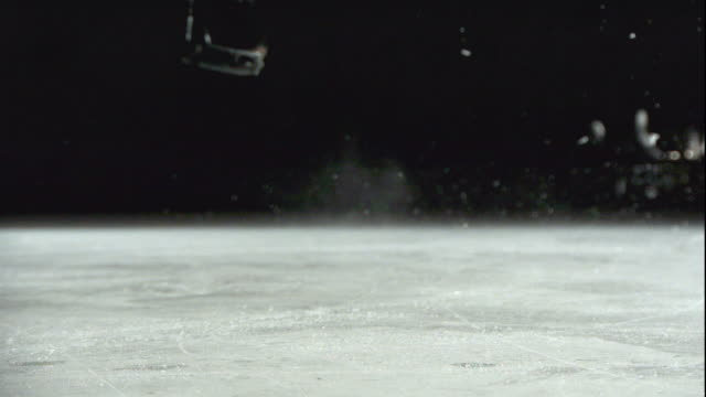 close up, locked down - blades of figure skates jump off the ice / usa - ice skating stock videos & royalty-free footage