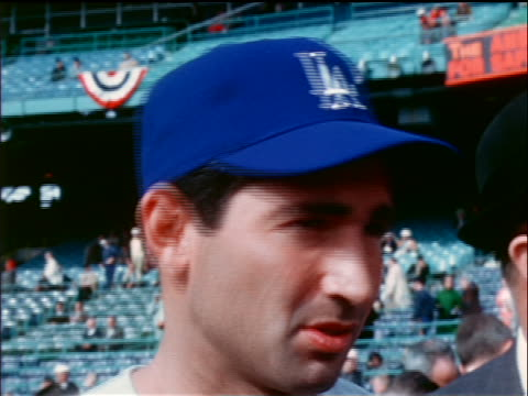 1965 close up low angle Dodger Sandy Koufax talking on field / industrial