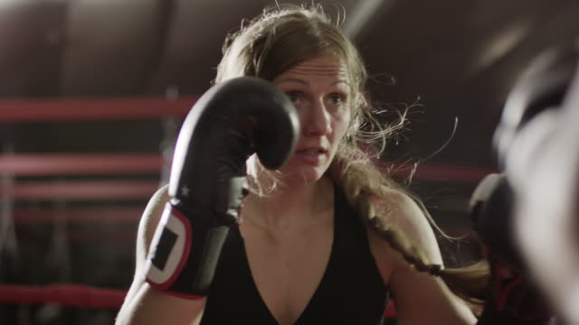 close up low angle panning shot of female boxer training / lehi, utah, united states - punch bag stock videos & royalty-free footage