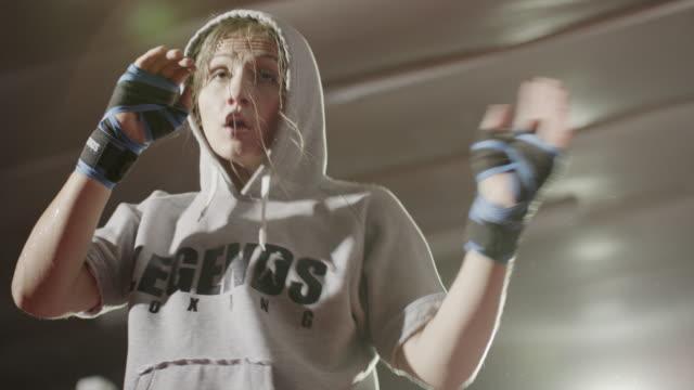close up low angle shot of female boxer practicing / lehi, utah, united states - lehi stock videos & royalty-free footage