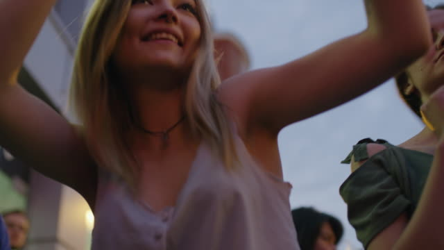 Close up low angle slow motion shot of women dancing outdoors / Plovdiv, Bulgaria