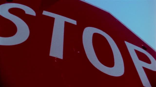 stockvideo's en b-roll-footage met close up low angle stop sign - cross processen