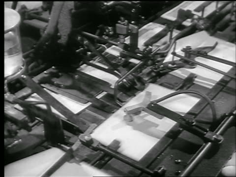 b/w 1944 close up machine putting war bonds into envelopes / world war ii / newsreel - 1944 stock videos and b-roll footage