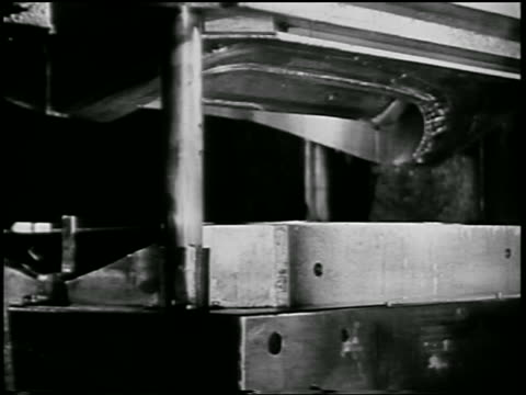 b/w 1932 close up machine stamping sheet of metal in ford car factory / industrial - 1932 stock videos & royalty-free footage