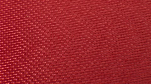 close up macro red ribbon fabric texture. textile background pattern - rug stock videos & royalty-free footage