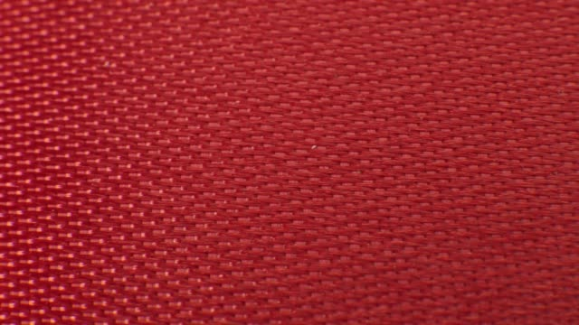 close up macro red ribbon fabric texture. textile background pattern - vignette stock videos & royalty-free footage