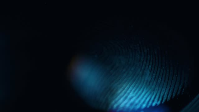 close up macro shot of a single human fingerprint lighting up on a glass surface, on july 27 2021, in bristol, united kingdom. - macro stock videos & royalty-free footage