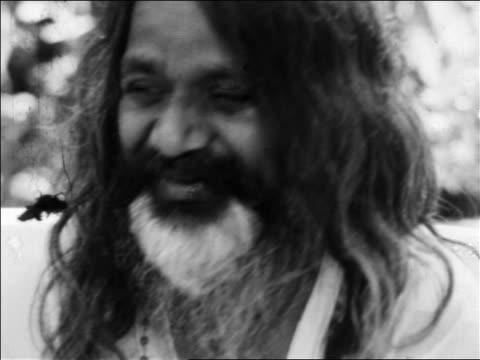 b/w 1968 close up maharishi maresh yogi smiling bouncing head / newsreel - maharishi mahesh yogi stock videos & royalty-free footage