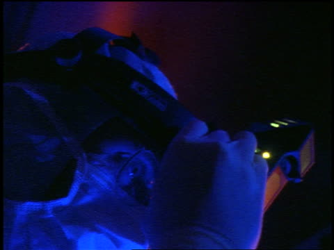 blue close up male doctor with eyeglasses putting headlight on during surgery - chirurgenkappe stock-videos und b-roll-filmmaterial