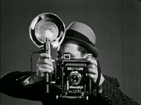 b/w close up male photographer taking photograph with camera - archival stock videos & royalty-free footage