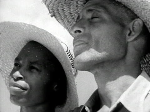 1942 close up man and woman wearing straw hats and looking into distance/ macon, georgia/ audio - georgia country stock videos and b-roll footage