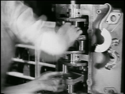 b/w 1932 close up man assembling auto parts in ford car factory / industrial - 1932 stock videos & royalty-free footage