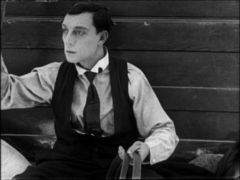 b/w 1922 close up man at reins of wagon tipping hat / feature - buster keaton stock videos and b-roll footage