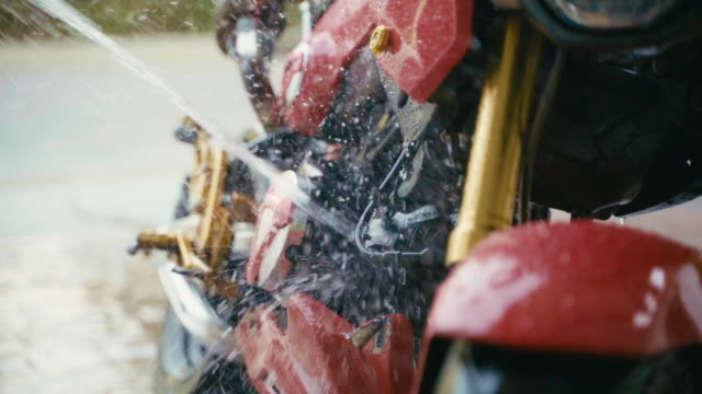 close up man clean washing motorcycle or bike at home with love to protection from corona virus covid-19 with slow motion 120 fps. - part of stock videos & royalty-free footage