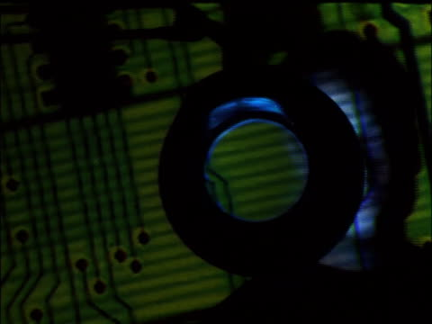 close up man examining projection of circuit board with eye magnified in circular device - one mid adult man only stock videos & royalty-free footage