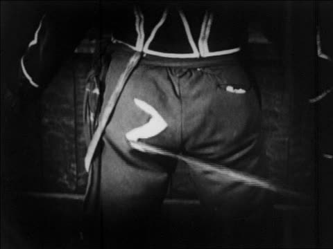 """b/w 1920 close up man getting """"z"""" carved in seat of his pants  / feature - knife crime stock videos & royalty-free footage"""