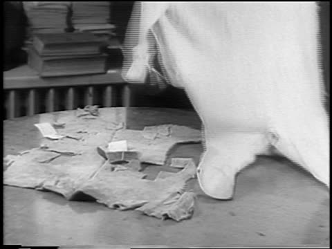 b/w 1935 close up man holding baby pajamas / evidence in lindbergh kidnapping trial / nj / newsreel - 1935 stock videos & royalty-free footage