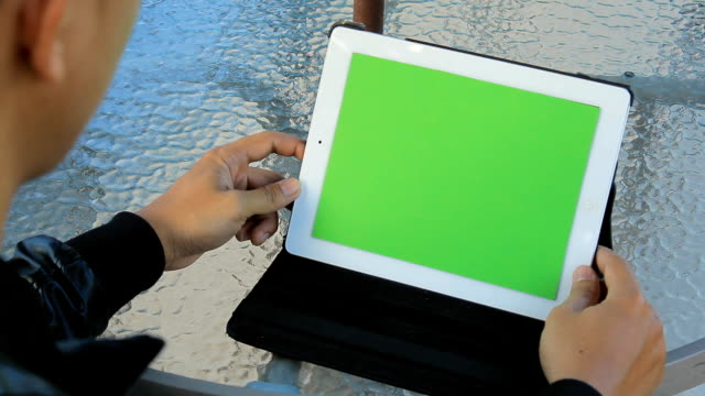 Close Up Man Holding Blank Tablet PC With Green