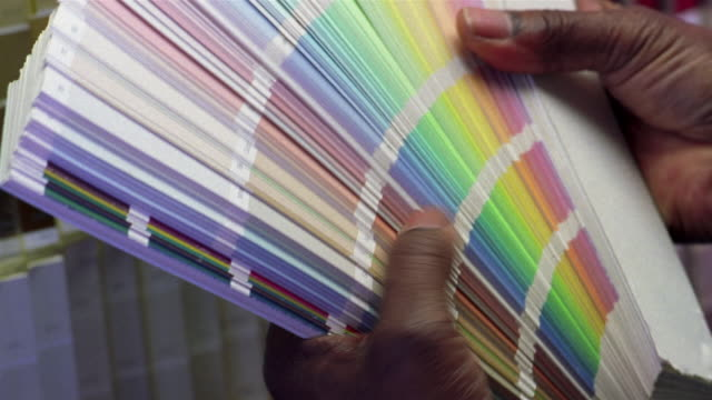 Close up man holding paint samples