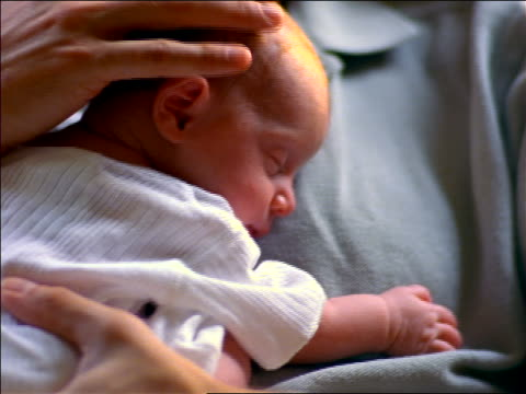 close up man holding + stroking sleeping newborn baby girl - chest stock videos & royalty-free footage