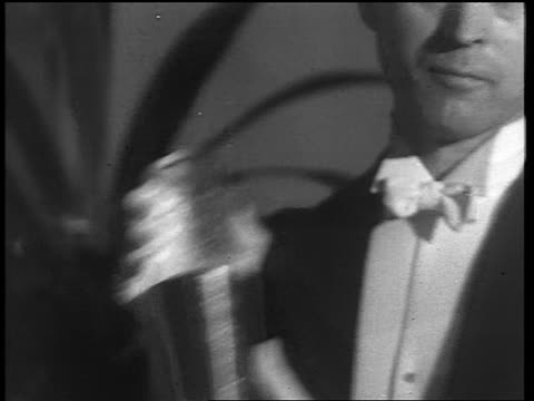 b/w 1933 close up man in formalwear shaking drink in cocktail shaker / end of prohibition - 1933 stock videos & royalty-free footage