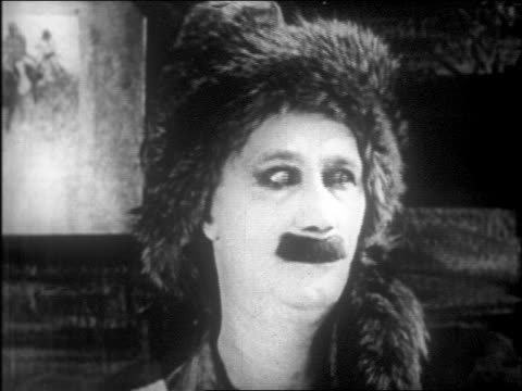 b/w 1916 close up man in furry hat (ben turpin) crossing + rolling eyes / feature - rolling eyes stock videos & royalty-free footage