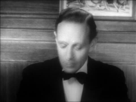 b/w 1934 close up man in tuxedo (leslie howard) talking towards camera / feature - 1934 stock videos & royalty-free footage