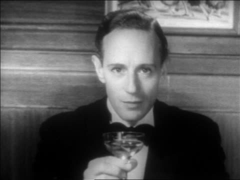 b/w 1934 close up man in tuxedo with champagne glass (leslie howard) talking towards camera / feature - tuxedo stock videos & royalty-free footage