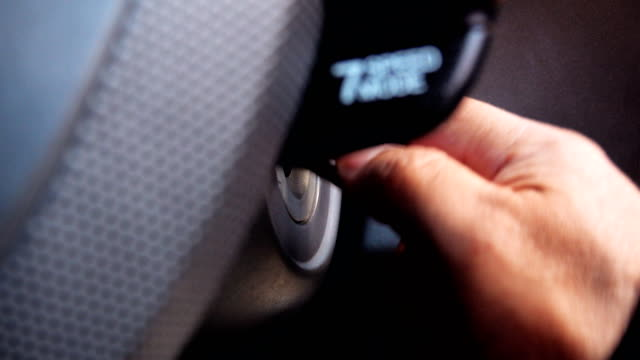 4K: Close up man inserting key into car to start.