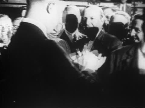 vídeos y material grabado en eventos de stock de close up man looking at other man writing memo + handing it to someone / newsreel - 1920 1929
