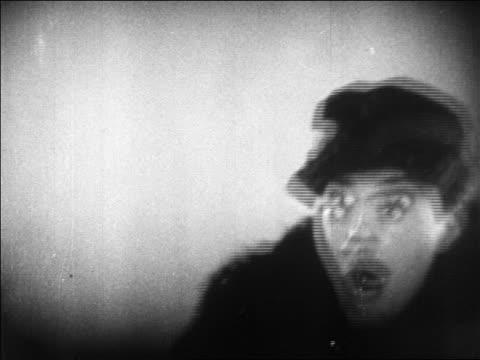 B/W 1920 close up man (Richard Barthelmess) looking shocked / feature