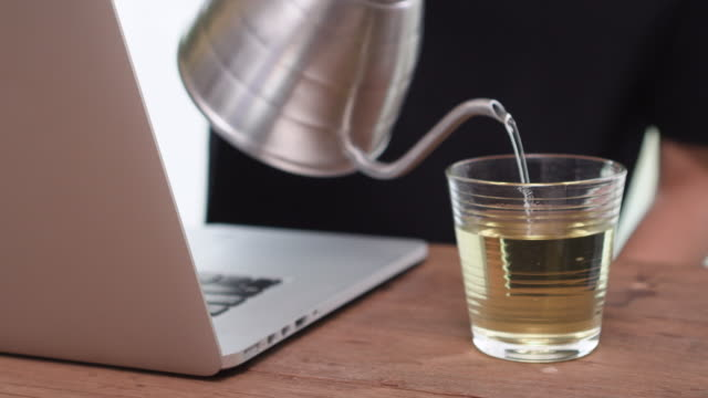 close up man pour or steep tea in to drinking cup - steep stock videos & royalty-free footage
