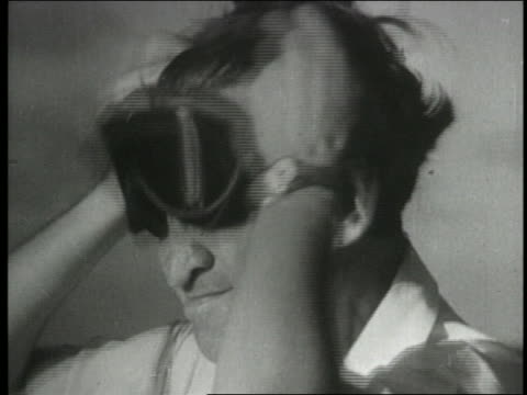 b/w 1954 close up man putting on goggles to view atom bomb explosion - 1954 stock videos & royalty-free footage