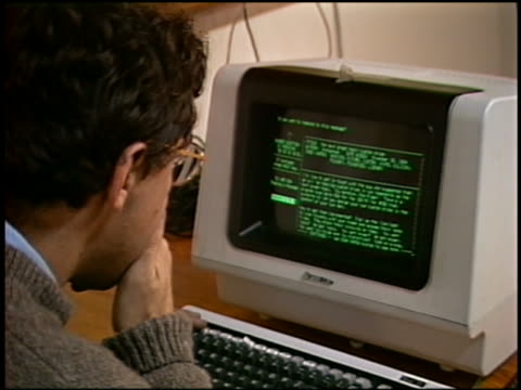 1984 close up man reading text on computer screen / marin, california - tecnico video stock e b–roll
