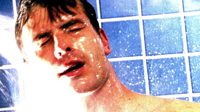 OVEREXPOSED close up man rinsing face + hair in shower