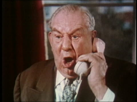 1959 close up man shouting into phone and getting angry / face turning red w/rain in background - anger stock videos & royalty-free footage