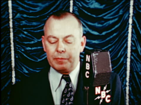 1945 close up man speaking into nbc radio microphone in studio / industrial - radio studio stock videos & royalty-free footage