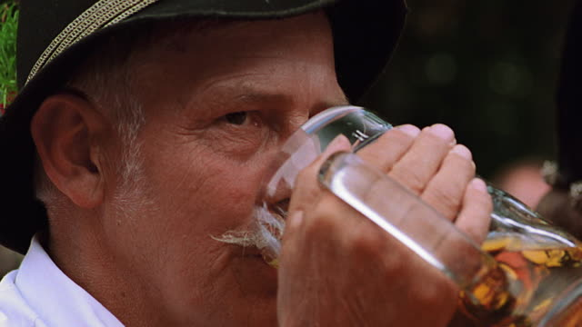 close up man wearing hat + drinking mug of beer / bad kohlgrub, bavaria, germany - moustache stock videos & royalty-free footage