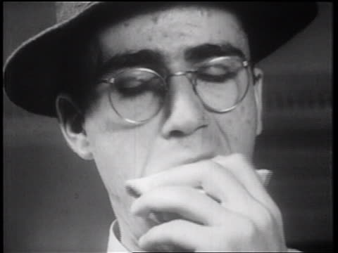 b/w 1939 close up man with eyeglasses + hat eating sandwich / documentary - sandwich stock videos & royalty-free footage