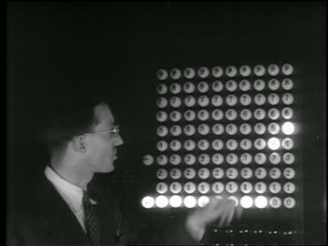 close up man with eyeglasses standing next eniac computer as numbers light up / u. of pennsylvania - b roll stock videos & royalty-free footage