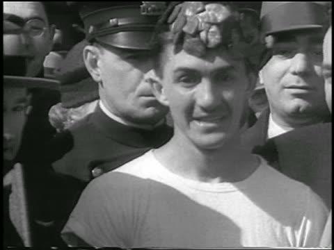 b/w 1933 close up man with laurel wreath on head / winner of boston marathon - 1933 stock videos and b-roll footage