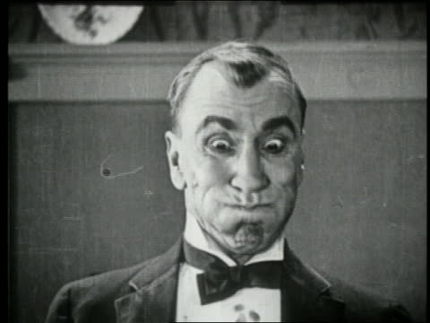 b/w 1924 close up man with mouth full making face + turning towards camera - disgust stock videos & royalty-free footage