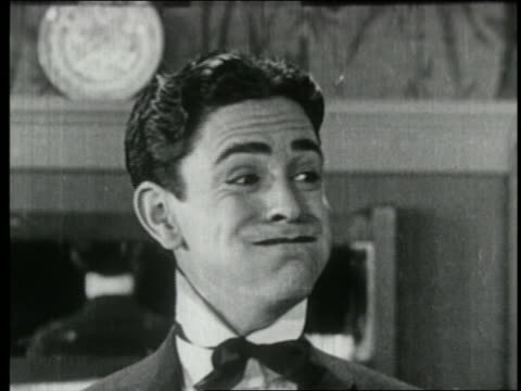 b/w 1924 close up man with mouth full smiling at someone offscreen - disgust stock videos & royalty-free footage