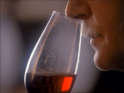 close up man with mustache sniffing bouquet of red wine / porto, portugal - moustache stock videos & royalty-free footage