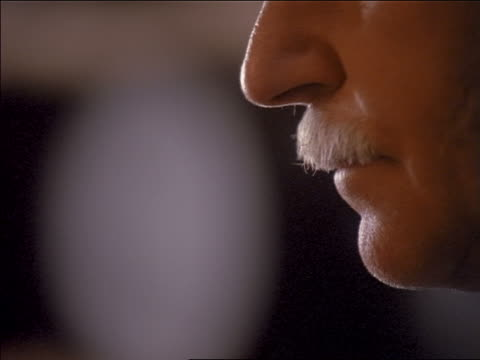 vidéos et rushes de close up man with mustache sniffing bouquet of wine + taking drink / porto, portugal - sentir