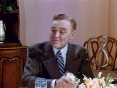 1952 close up man with suit sitting at table talking to someone off screen / industrial - one mid adult man only stock videos & royalty-free footage