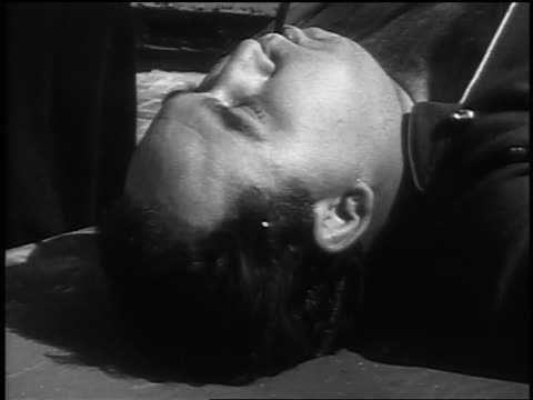 vídeos y material grabado en eventos de stock de b/w 1937 close up man with tube in mouth lying down - only mature men